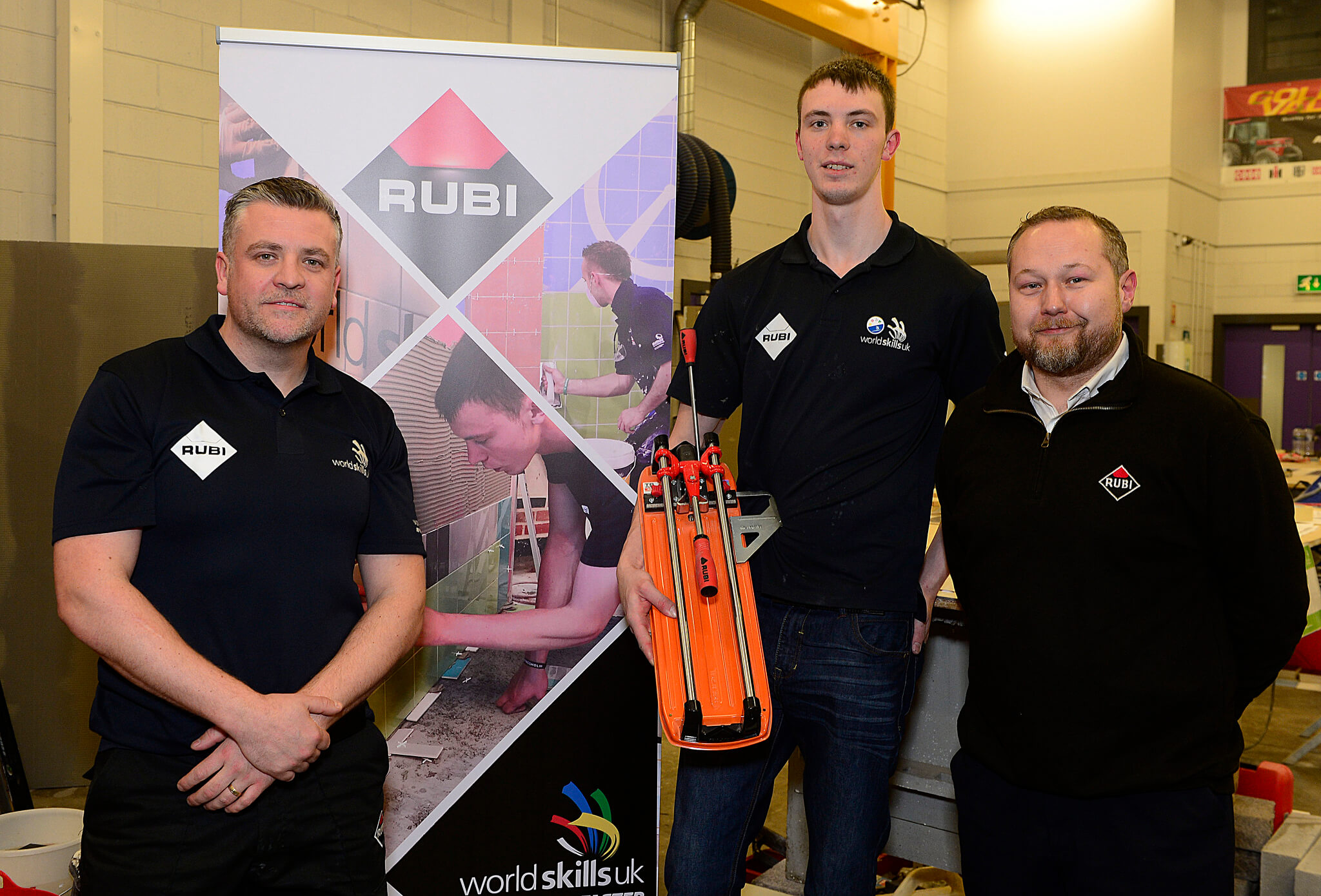 The UK WorldSkills trainer for Wall and Floor Tiling section, Paul Doran, next to Mark Scott and the Sales Rep for RUBI Ireland, Richard Morton.